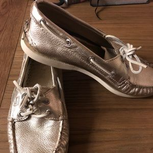 Gold Sperry boat shoes